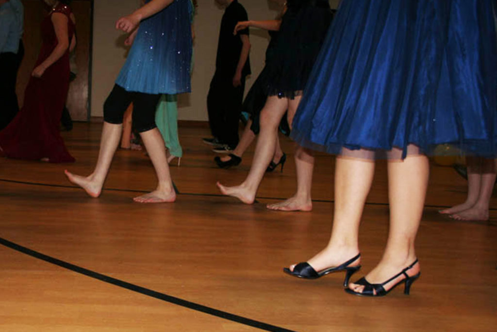 Agape held its first Prom where the teens sat down to a formal dinner, learned line dancing, enjoyed games and playing air guitar to their favorite songs.